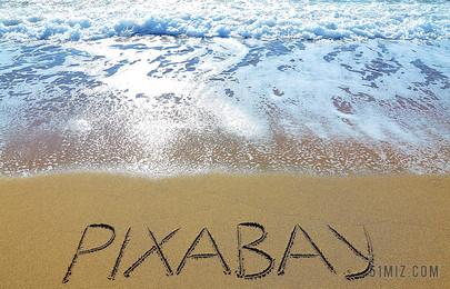黃藍攝影創意海邊沙灘上的英文文字旅游自然大海背景圖片