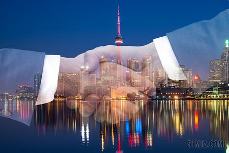城市商務握手合作繁華都市城市圖片